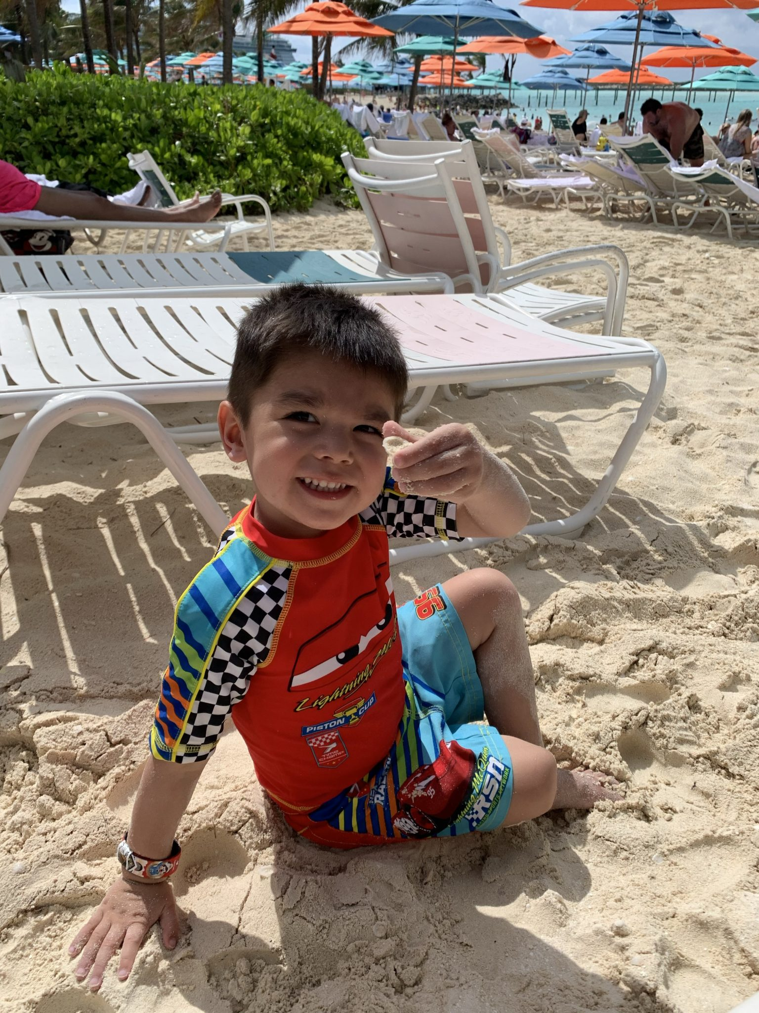 Castaway Cay Activities: a Complete Guide to Beaches and Events featured by top US Disney blogger, Marcie and the Mouse: Boy holding up a shell at a Castaway Cay beach
