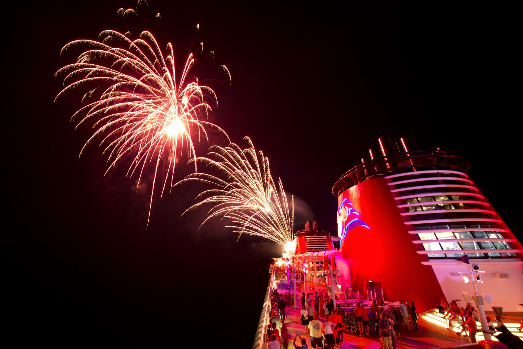 """Top 10 Things to Do on Disney Fantasy featured by top US Disney blogger, Marcie and the Mouse: Disney Cruise Line lights up the sky to dazzle guests with the largest, awe-inspiring fireworks extravaganza presented aboard a cruise ship. The skies above the Disney Fantasy and the Disney Dream explode with brilliant colors during """"Buccaneer Blast!"""" – a pyrotechnic spectacular choreographed to a dramatic score featuring songs from the """"Pirates of the Caribbean"""" movies. (Gregg Newton, photographer)"""