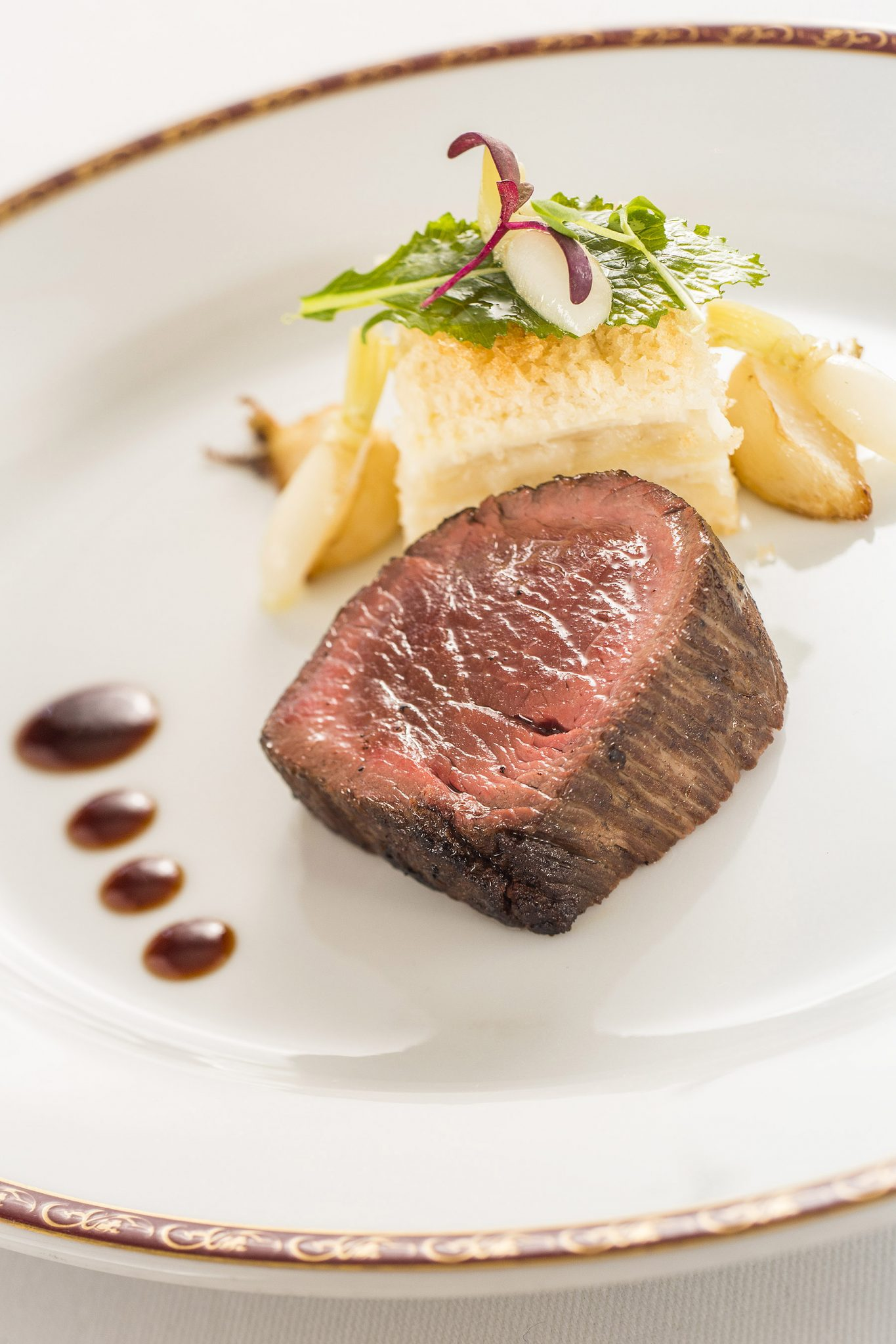 Disney Fantasy Dining: Where to Eat on Your Disney Cruise, tips featured by top US Disney blogger, Marcie and the Mouse: Kobe beef with turnip and potato gratin, served with thyme jus. Chef Arnaud Lallement, Remy (Matt Stroshane, photographer)
