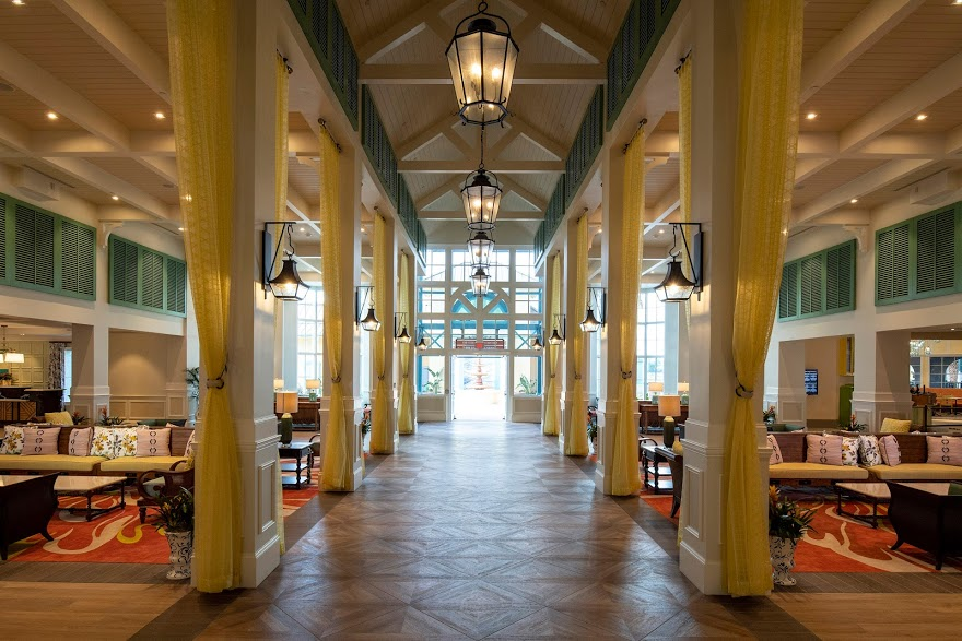 Walt Disney World Hotel for Every Budget featured by top US Disney blogger, Marcie and the Mouse: The Old Port Royale complex has been reimagined as a new port of entry for Disney's Caribbean Beach Resort. It's a centralized and convenient location for services, amenities and three new dining options. Guests arrive at Old Port Royale via an all-new porte-cochere, where they are welcomed into a colorfully reappointed lobby under an open-trussed roof and a colonnade with floor-to-ceiling drapes. Friendly cast members are waiting in this open and communal environment to help guests check in to their rooms, answer questions, offer advice to help them better enjoy their stays and more.
