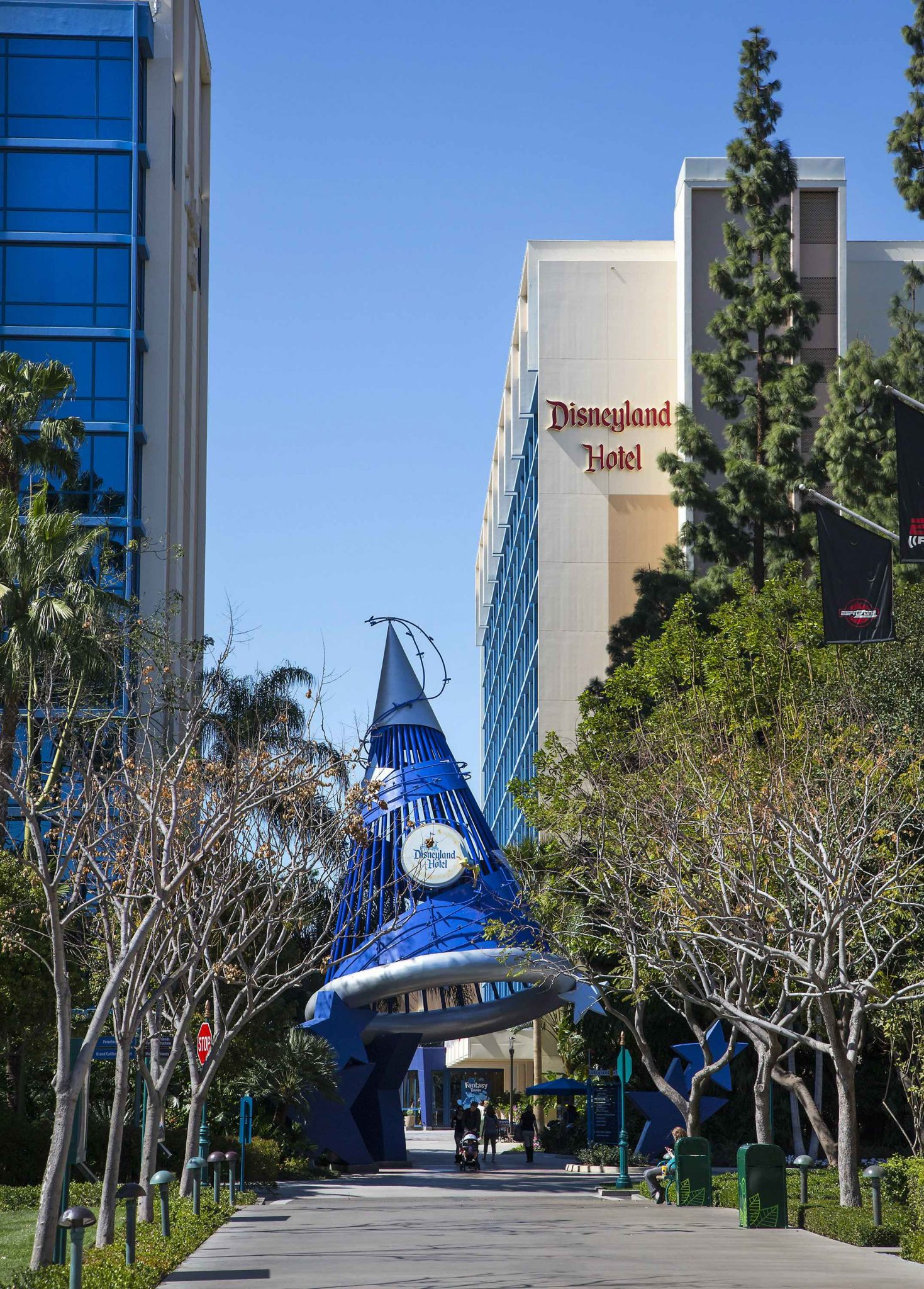 10 Reasons to Stay at the Disneyland Hotel featured by top US Disney blogger, Marcie and the Mouse: DISNEYLAND HOTEL––Follow Tinker Bell's twinkling lights underneath the Sorcerer's Hat to the Disneyland Hotel. Featuring three themed towers, a pool-and-slide water play area, Tangaroa Terrace and Trader Sam's bar, the Disneyland Hotel is one of three Disneyland Resort Hotels conveniently located near Disneyland and Disney California Adventure parks and the Downtown Disney District. (Paul Hiffmeyer/Disneyland Resort)