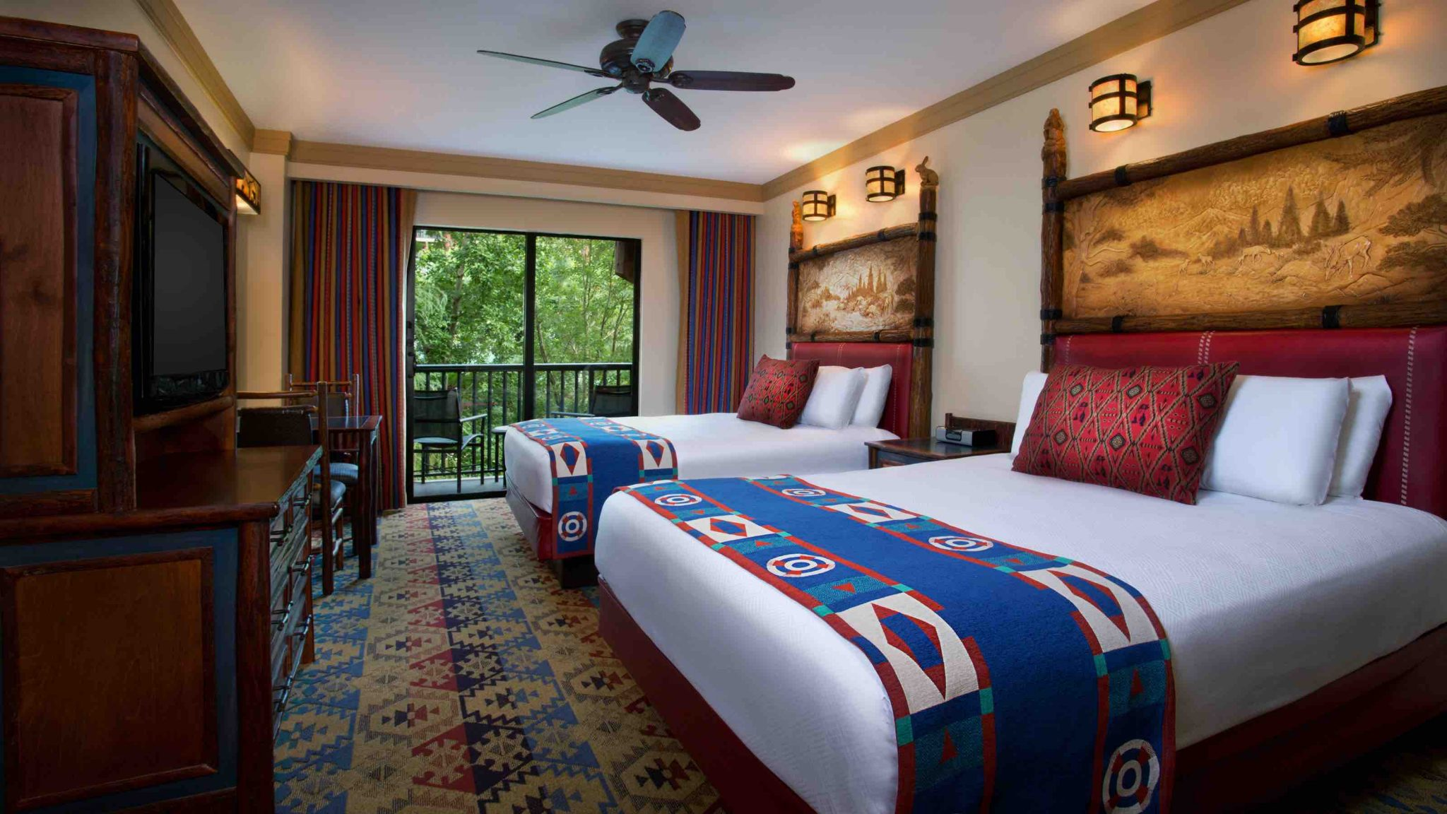 Walt Disney World Hotel for Every Budget featured by top US Disney blogger, Marcie and the Mouse:Inspired by turn-of-the-century national park lodges, Disney's Wilderness Lodge combines rustic charm with a contemporary flair on the shore of Bay Lake at Walt Disney World Resort. The 727-room hideaway features a spectacular six-story lobby, replete with teepee-topped chandeliers, totem poles, an 82-foot-tall stone fireplace and a bubbling hot spring that expands outside the building into a roaring waterfall. Walt Disney World Resort is located in Lake Buena Vista, Fla. (Disney)