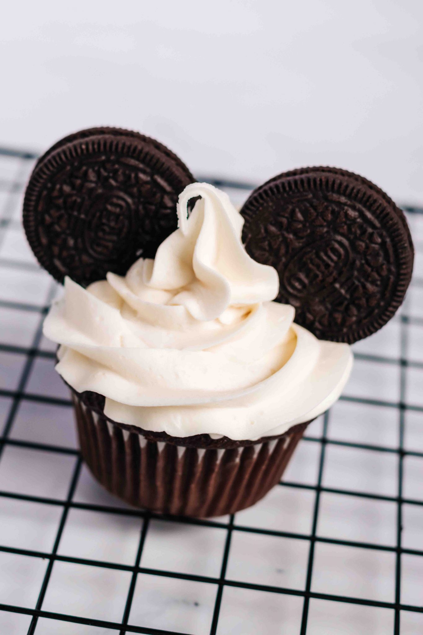 Super Easy Mickey Mouse Cupcakes featured by top US Disney blogger, Marcie and the Mouse.